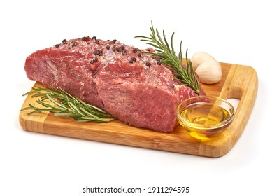 Raw veal meat with spices and oil, prepared for cooking, isolated on white background.