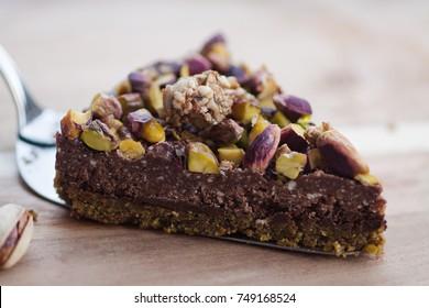 Raw vegan chocolate cake with pistachio