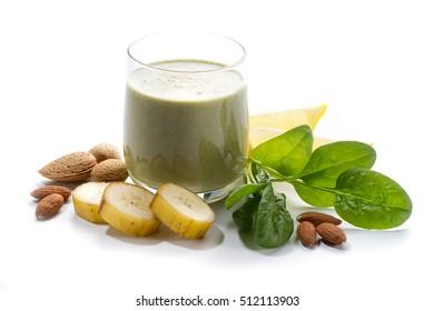 Raw vegan food: banana, almond milk, lemon and spinach smoothie