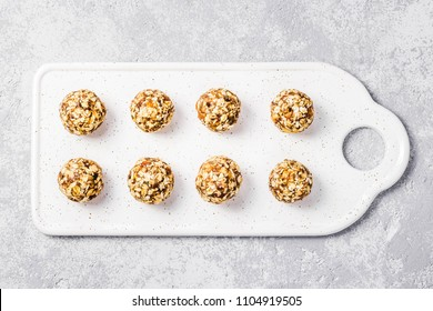 Raw vegan healthy dessert, date and nuts bliss balls. Top view, space for text.