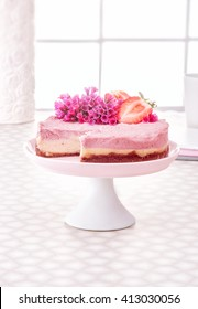 Raw vegan strawberry or raspberry cheesecake gluten-free on a white decorate table and window background, Raw Vegan Paleo Diet Cheesecake Gluten-Free with Dates and Cashews,  Horizontal