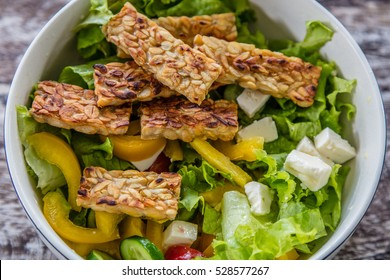 Raw vegetable and lettuce salad with tempe goreng, fried tempeh, Bali Island, Indonesia
