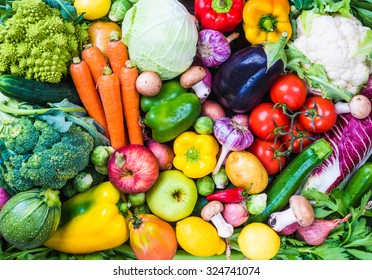 Raw vegetables and fruits background.Healthy organic food concept. - Shutterstock ID 324741074