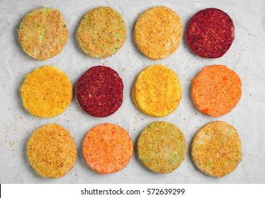 Raw Vegetables patties cutlets for vegan burgers on white paper. Mix stack vegetables fresh burgers patties cutlets. Top view. Flat lay.