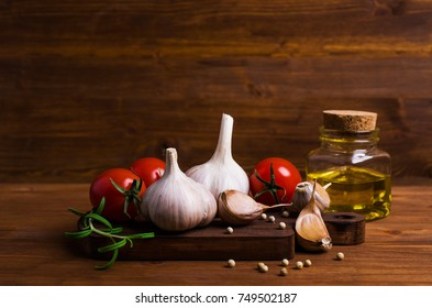 Raw vegetables and spices on a wooden background. Selective focus.