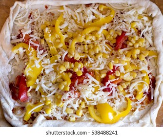 raw vegeterian pizza toppings with cheese end tomato