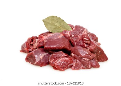 Raw venison from deer as goulash with bay leaf