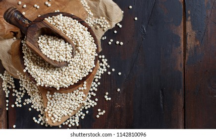 Raw White Sorghum grain on a wooden table