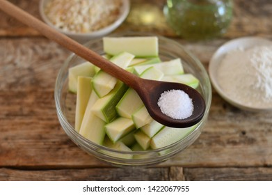 Raw zucchini, cut into pieces, in a glass bowl