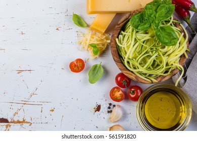 raw zucchini pasta and ingredients, copy space