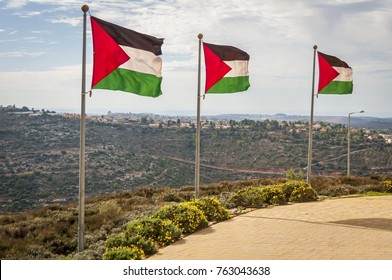 RAWABI, PALESTINE AUTHORITY, WEST BANK. November 25, 2017. A row of Palestine flags on the top of the hill in Rawabi, the flagship housing project in Palestine.