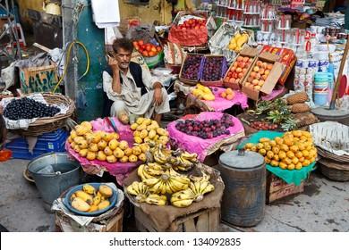 RAWALPINDI, PAKISTAN - JULY 16: Unidentified Pakistani man sells fresh fruits at Raja Bazaar on July 16, 2011 in Rawalpindi, Pakistan. Raja Bazaar is the main tourist attraction in Rawalpindi.