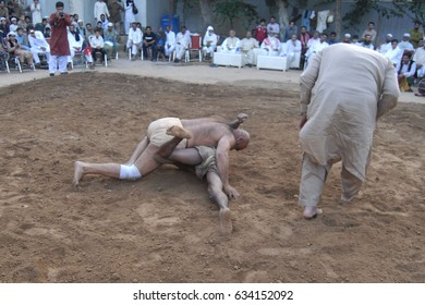 RAWALPINDI, PAKISTAN - MAY 05: Wrestlers are in form in ring during match at Liaquat  Bagh, on May 05, 2017 in Rawalpindi.