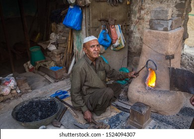 Rawalpindi, Pakistan, October 7, 2017. Man is working in his workshop and moulding Iron pieces.