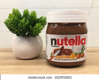 Rawang, Malaysia - February 13, 2017: Jar of Nutella Hazelnut on wooden table. Nutella is the brand name of a chocolate hazelnut manufactured by Italian company Ferrero.