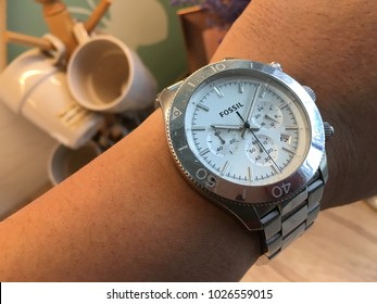 RAWANG, MALAYSIA- FEBRUARY 17, 2018: Man wearing a FOSSIL watch. Fossil main product was fashion watches with a retro look, founded in 1984.