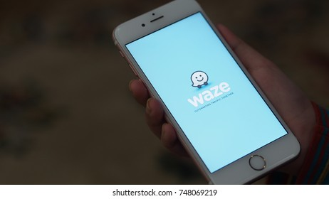 RAWANG, MALAYSIA - NOVEMBER, 2017: Person holding Apple iPhone 6S with a Waze GPS application on the screen. Waze is one of the most popular GPS applications.