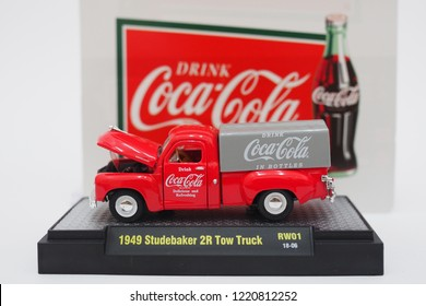 Rawang, Malaysia - November 4, 2018: Vintage Coca-Cola die cast red truck. 1949 Studebaker 2R Tow Truck.