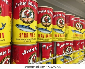 RAWANG, MALAYSIA - SEPTEMBER 15, 2017 : Row of Ayam (Chicken) Brand Sardines cans display on the shelf at hypermarket. Ayam Brand believes only in quality ingredients prepared naturally.