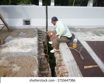 Rawang, Selangor. Feb 20 2019. Worker is rectifying the surface of concrete for construction of bridge expansion joint.
