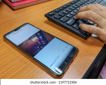 Rawang, Selangor, Malaysia, 7th October 2018 -  View of screen shot of shutterstock sold page with a hand holding a keyboard