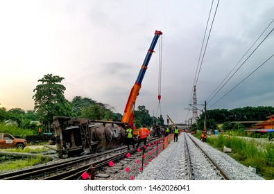 Rawang, Selangor, Malaysia - July 18, 2019: Recovered wegon derailment near rawang ktm  Station. Crews working on repairs wegon derailment.