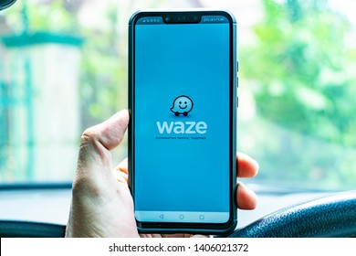 Rawang, Selangor / Malaysia - May 24th 2019: A driver is using WAZE app for driving direction.  WAZE has become an essential part of a motorist's daily routine for driving guidance and assistance.