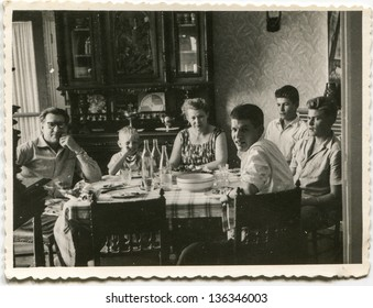 RAWICZ, POLAND, CIRCA 1940 - Vintage photo of unidentified big family dining together, Rawicz, Poland, circa 1940