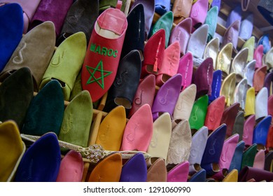 Raws of traditional moroccan slippers of different colors, market in Rabat, Morocco