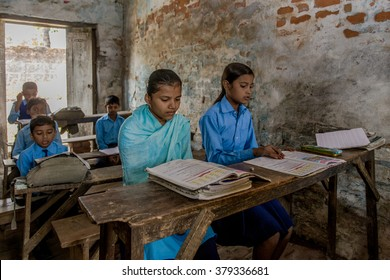 RAXAUL, INDIA - NOV 11: Unidentified Indian pupil in a local school on Nov 11, 2013 in Raxaul, Bihar, India. Bihar is one of the poorest states in India. The per capita income is about 300 dollars.