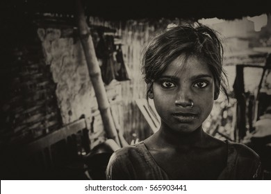 RAXAUL, INDIA - NOV 12: Unidentified Indian girl on Nov 12, 2013 in Raxaul, Bihar state, India. Bihar is one of the poorest states in India. The per capita income is about 300 dollars.