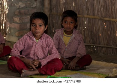 RAXAUL, INDIA - NOV 14: Unidentified Indian pupil in a local school on Nov 14, 2013 in Raxaul, Bihar, India. Bihar is one of the poorest states in India. The per capita income is about 300 dollars.