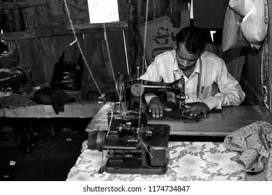 RAXAUL - NOV 7: Indian man working in his sewing workshop on Nov 7, 2013 in Raxaul, Bihar state, India.