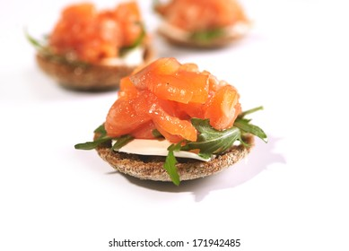 ray bread with cream cheese and smoked salmon over white background