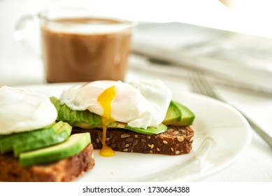 ray bread toast with avocado and egg poached