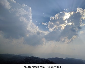 A ray of light escapes through the clouds over Aizawl, Mizoram