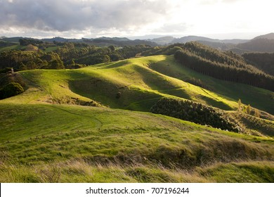Ray of light on a north landscape of New Zealand, green meadows and valleys
