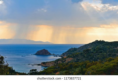 Ray of lights on mediterranian sea in tuscany countryside, nature and scenic aerial view of blue sea against cloudy sky. From Island on background. Monte Argentario (Grosseto). Tuscany. Italy