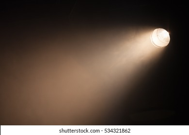 Ray of scenic spot light over dark background, stage illumination equipment