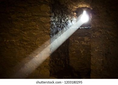 Ray of sunshine penetrating through a loophole in the castle