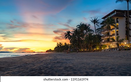 Rayong beach with sunset and resort background, coconut palm and hotel on the beach in summer, Rayong city, Thailand