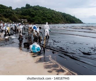 RAYONG -JUL 31: Oil stain in the water of Aou Prow beach, Rayong, Thailand on Jul 31, 2013. The disaster came from leaked oil from the oil tanker unloading in the sea on July 27.