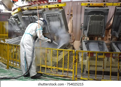 Rayong province Thailand , Nov 12 , 2017 : Unidentified thai man working the mold preventive maintenance for cleaning mold by using dry ice