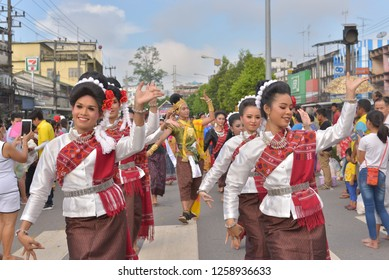 Rayong, TH - October 25 : Women of Baan Sam Yan are dance in Buddhism ceremony on the end of Buddhist Lent on the street at Baan Sam Yan, Klaeng district on the October 25, 2018 in Rayong, TH