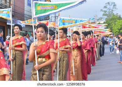 Rayong, TH - October 25 : Women of Sam Yan joint to buddhism ceremony on the street on the end of Buddhist Lent at Baan Sam Yan, Klaeng district on the October 25, 2018 in Rayong, TH