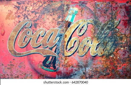 RAYONG, THAILAND - 21st September, 2014:  An Old rusted vintage Coca Cola advertising sign, Rayong, Thailand, 21st September, 2014.