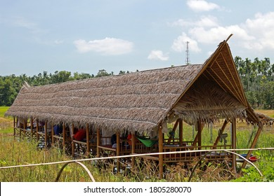 Rayong, Thailand - 29th August, 2020: A long thatched wooden hut constructed as a dining area at a rural restaurant called Somtam Sadit in Ban Kai district, eastern Thailand.