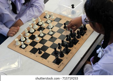 Rayong, Thailand - 8th September, 2017: Thai high school girls play a game of chess in class as part of a club activity, Rayong Province, eastern Thailand.