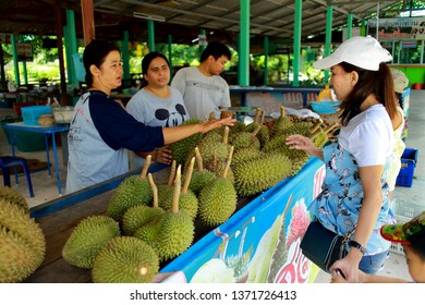 Rayong Thailand , April 07 - 2019 : Thai people buying fresh fruit at fruit market in Thailand.