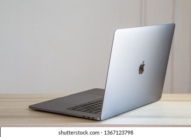 Rayong , Thailand - April 6 , 2019 : MacBook Pro space grey laptop by Apple on wooden table